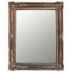 Gilt Carved Wood and Ebony Strié Mirror
