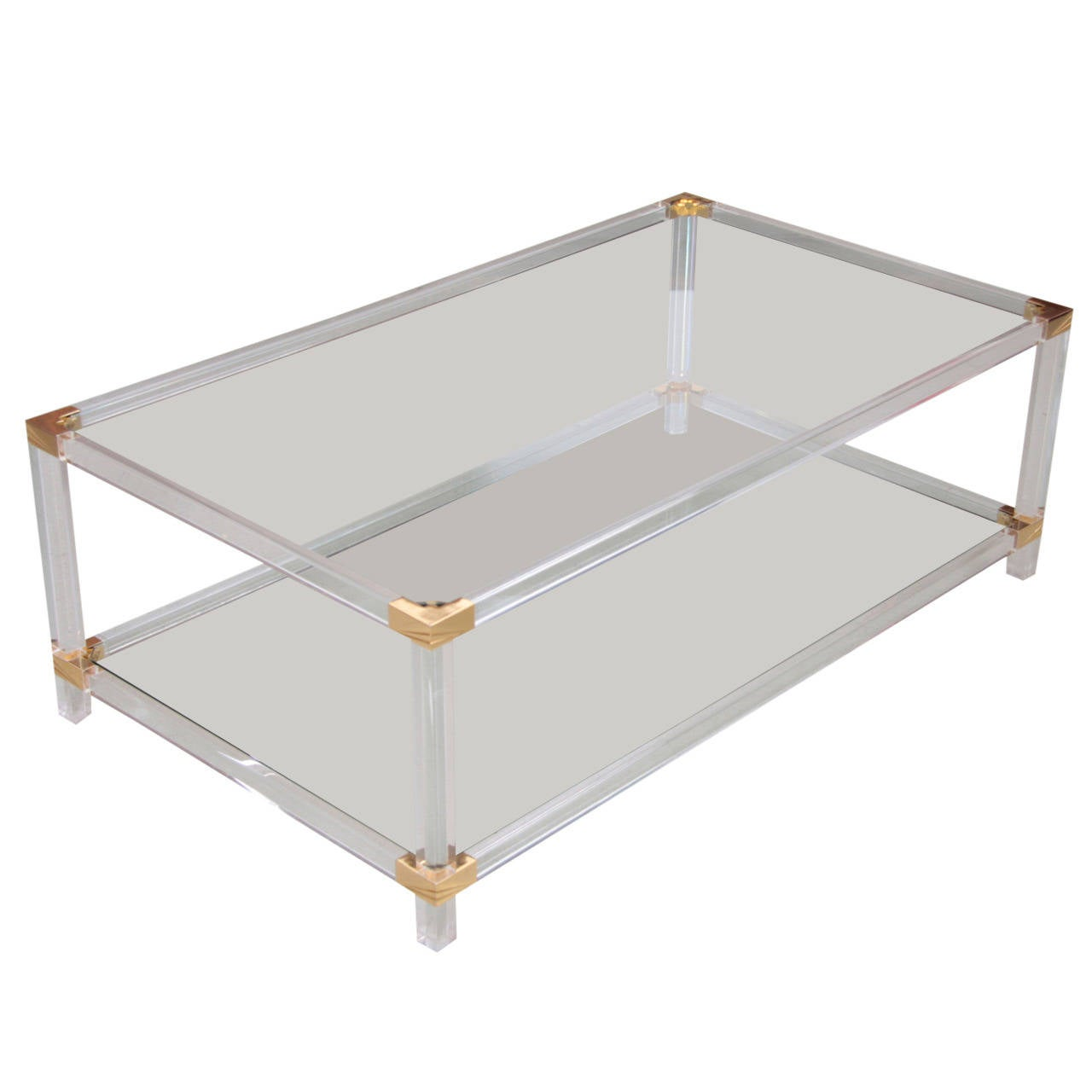 Two tier lucite and brass coffee table in the style of for Lucite and brass coffee table