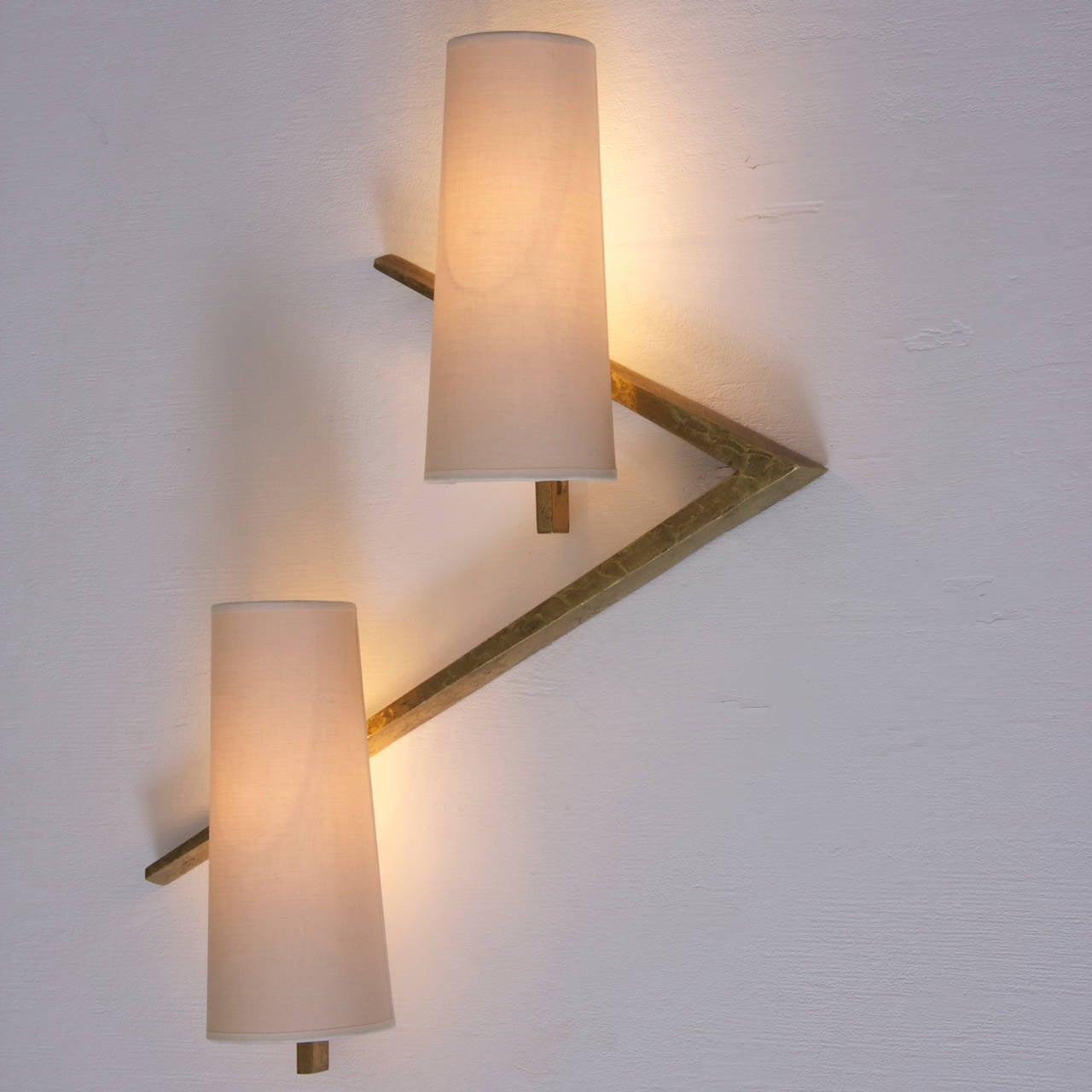 Stunning pair of bronze wall lamps. The wall lamps are in excellent condition. Each lamp is fitted with two E14 bulb.
