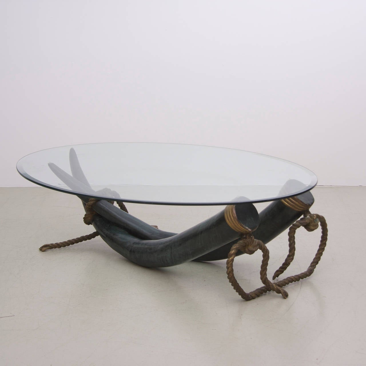 Wonderful Huge Elephant Tusk Coffee Table With Oval Glass Tabletop Tusks Are Made Of Bronze
