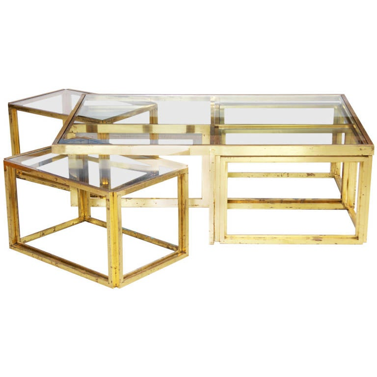 This Maison Charles Brass Coffee Table With Four Nesting Tables Is No