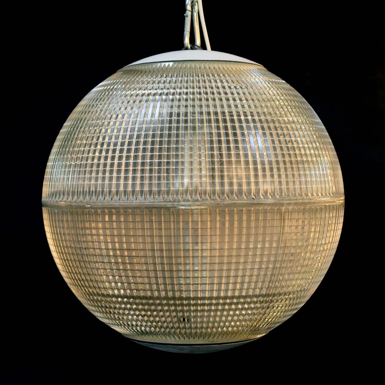 French spherical holophane pendant lights, circa 1960-1980, moulded glass. Some small nicks and blemishes to the glass, please request more images if neccessary. 20kg each. Re-wired and PAT tested.