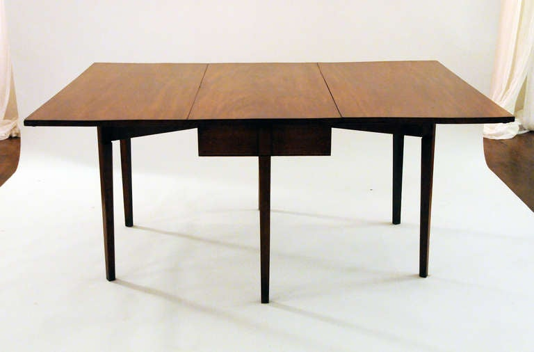 this vintage walnut dining table is no longer available