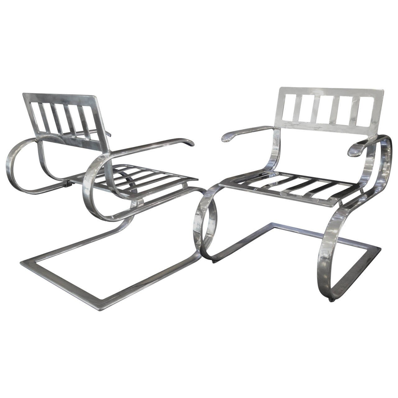 Pair of Aluminum Lounge Chairs and Ottoman