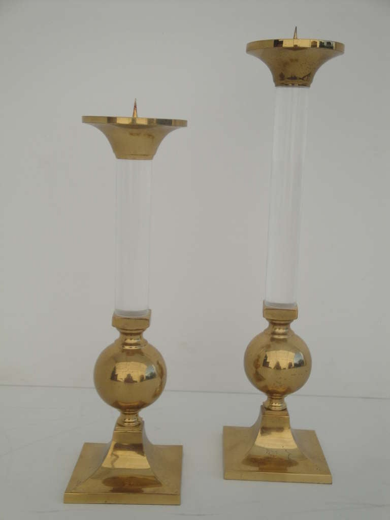 Pair of brass and glass candle holders style of Karl Springer Large one is 18