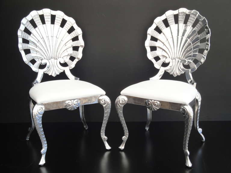 Set of eight polished Venetian grotto style aluminum shell dining chairs. Priced individually.