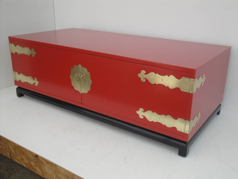 Hollywood Regency red lacquered coffee table or cabinet.