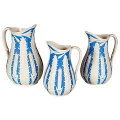 Set of Three Parian Porcelain Pitchers