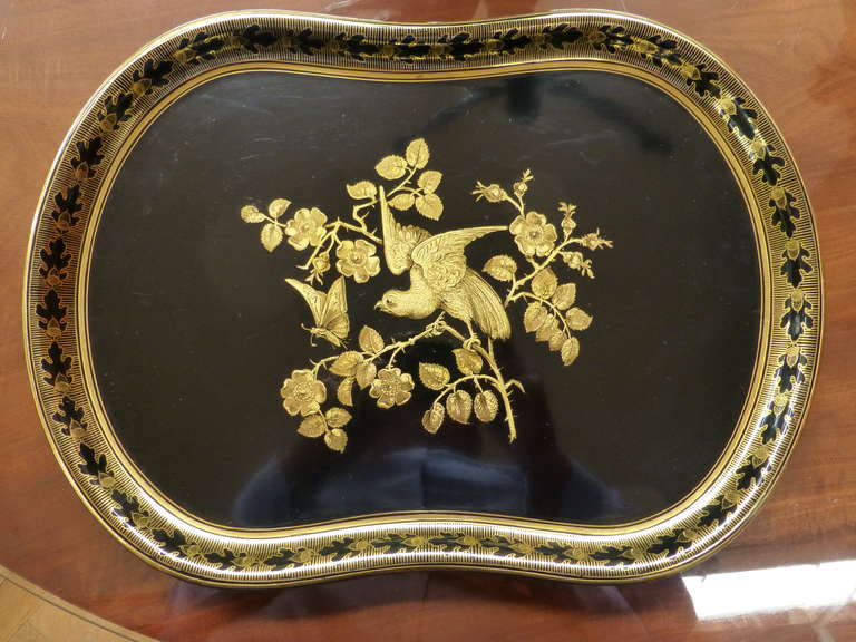 Shaped oval, the centre painted with flowering branches of roses with a bird and a butterfly, the border with a band of acorns and oak leaves. The first patent for papier mâché was registered by Henry Clay of Birmingham in 1772. Papier mâché is an