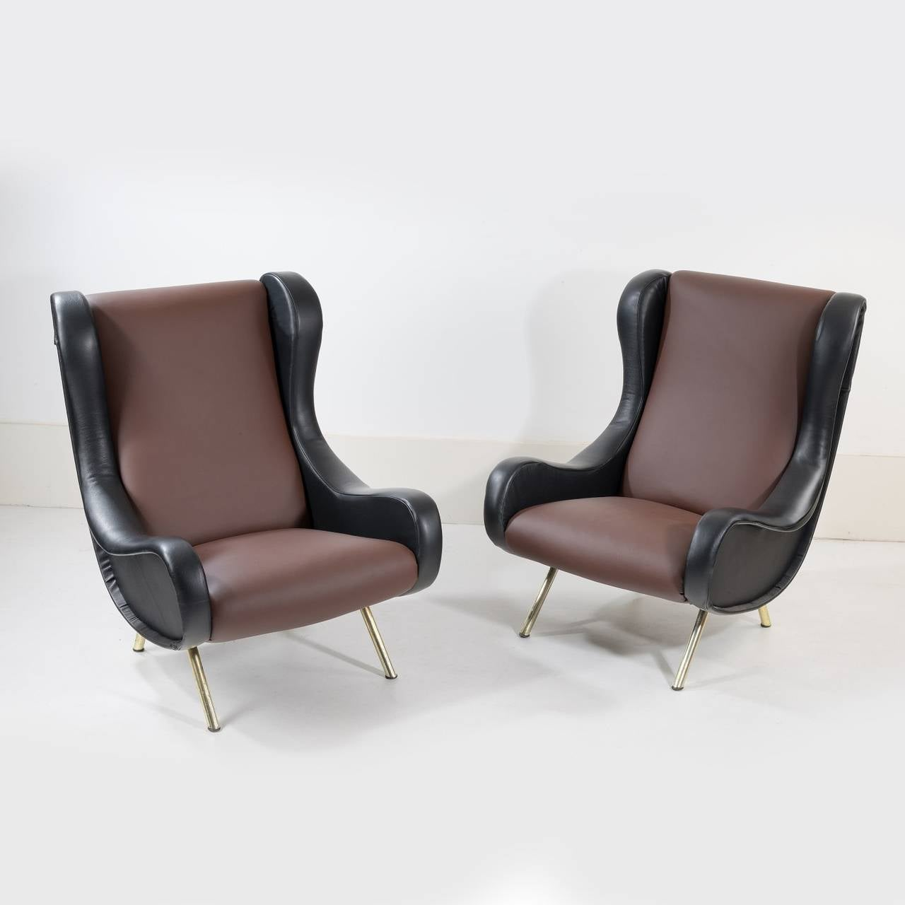 Pair of armchairs Model 'Senior' designed by Marco Zanuso and edited by Arflex. They have been reupholster in dark brown and black leather.