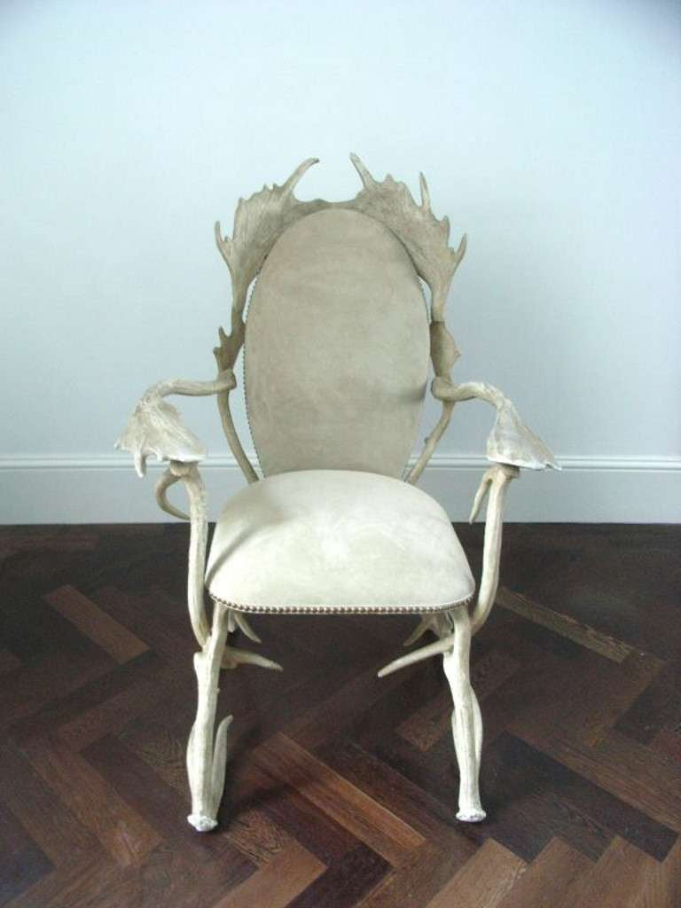 Unusual chair designed by Arthur Court and made in aluminium to represent a traditional chair made from antlers. The seat is upholstered in suede.