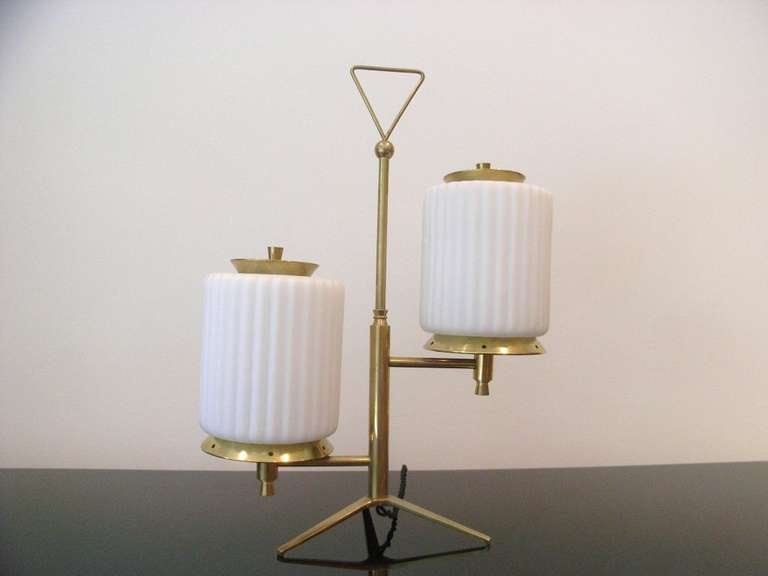 Stylish table lamp with two ribbed opaque glass shades by Arteluce