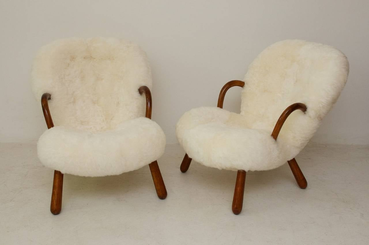 Pair of 'Clam' armchairs designed by the Danish architect Philip Arctander (1916-1994) with arms and legs of polished beech and reupholstered in shorn sheepskin. Designed in 1944 and produced in the late 1940s by Nordisk Staal & Møbel Central.
