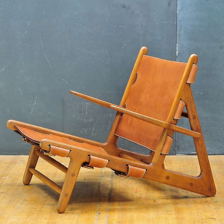 A very rare hand produced and retains original paper labeled remnants, hunting chair. Handmade by Erhard Rasmussen in 1948-1950 for Borge Mogensen. Retains most of original labels, the original brass sling hardware, with newly upholstered with