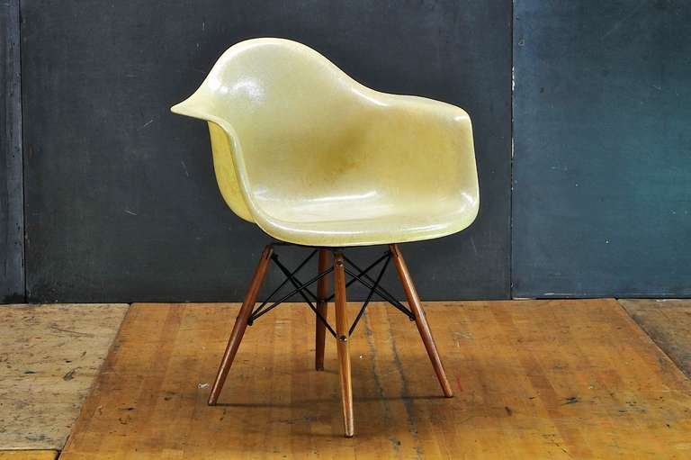 Charles and Ray Eames paw walnut dowel leg fiberglass swivel armchair for Zenith Plastics / Herman Miller Inc. A 1st generation/production rope edge fiberglass armchair example.   Fresh from original owner's estate. Very good vintage condition.