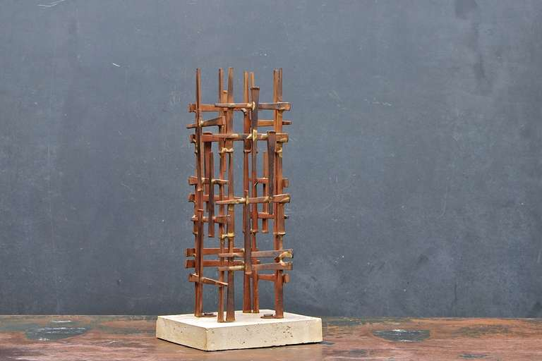 David Grossman's cast iron spikes brazened into a skyscraper sculpture on foundry stone base.
