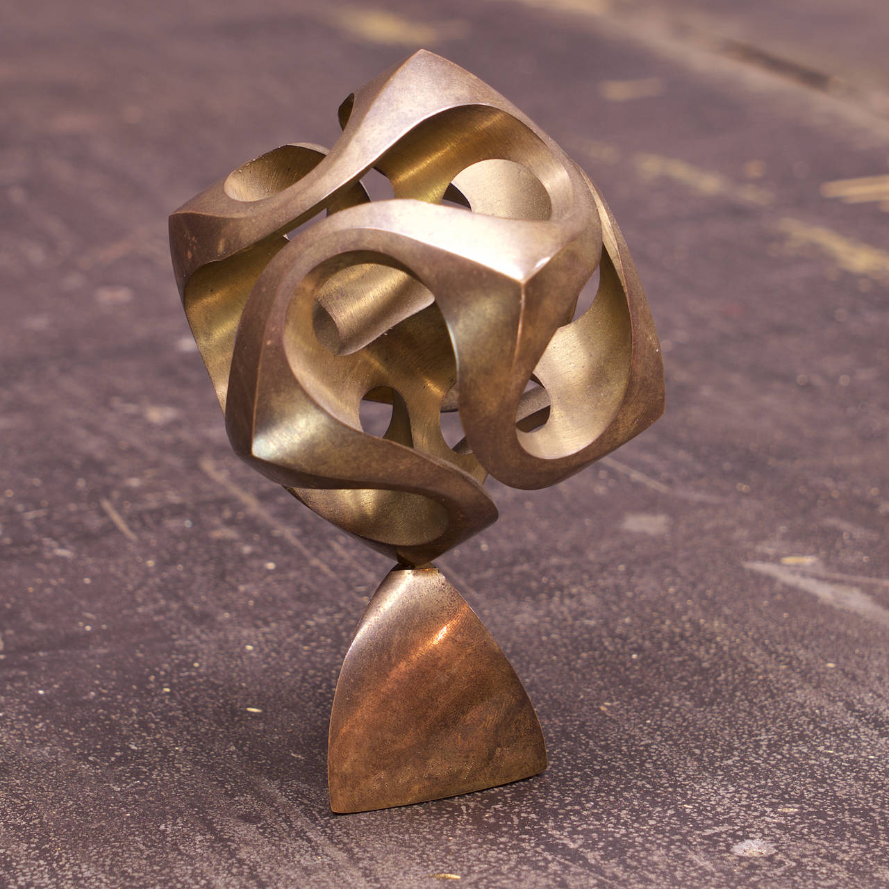 Rare and Early MOMA/MIT Mathematical Statuette, 80/1000. Solid Bronze Swiveling Sphere on Bronze Base. Signed, Numbered.  Dia: 3.5 x H: 5.25 in.
