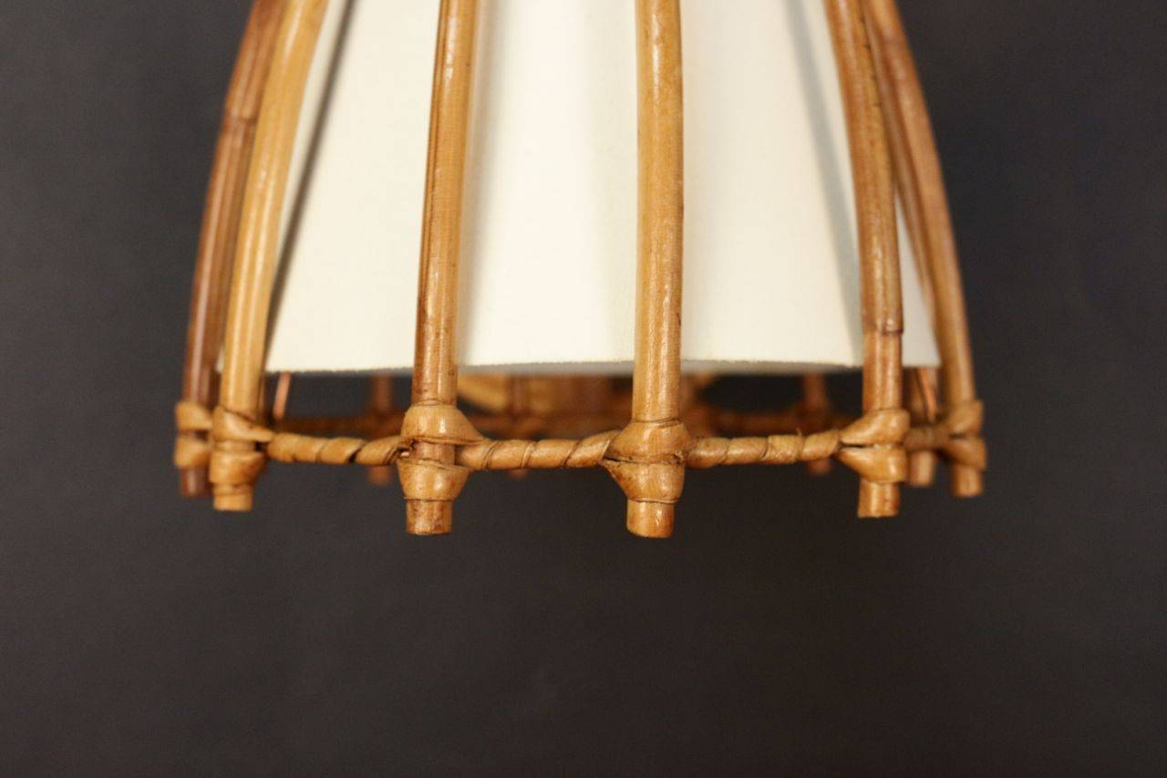 Mid-20th Century Pair of Rattan Sconces Attributed to Louis Sognot For Sale
