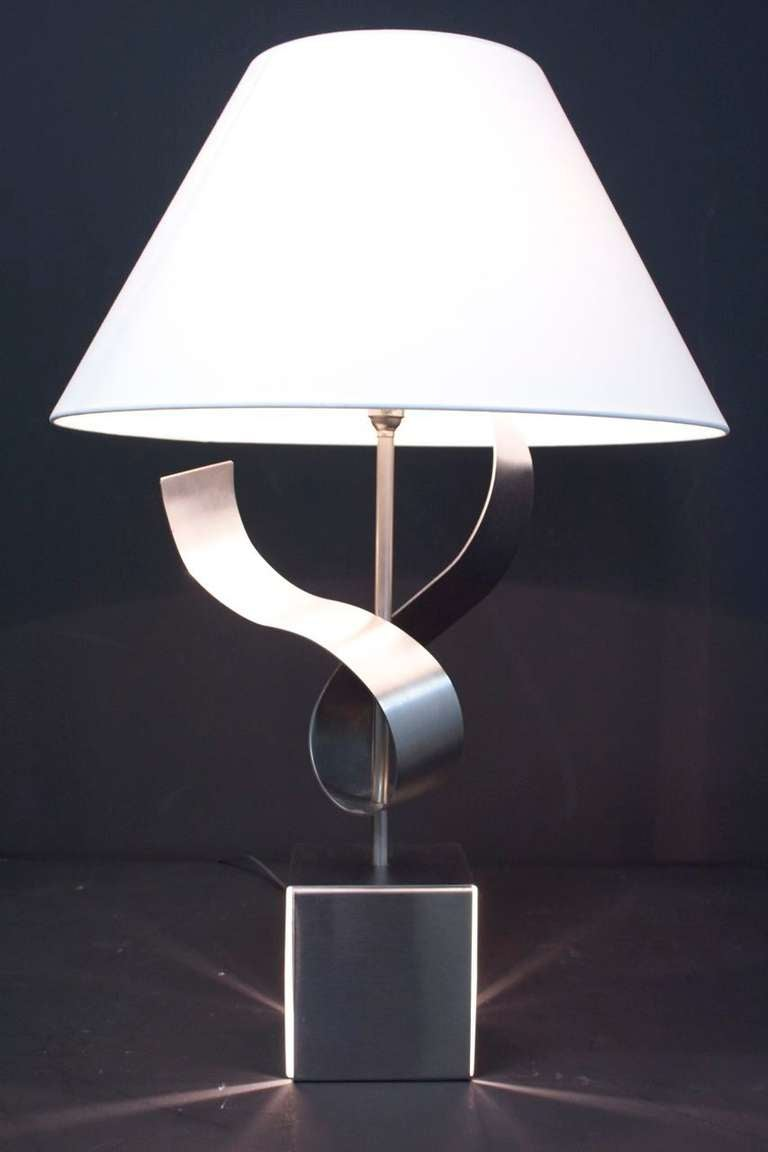 1970s sculpture table lamp byFrançois Monnet, 1970.  Metal with two-light sources.  One standard under the shade and the second one the sculpture folding.