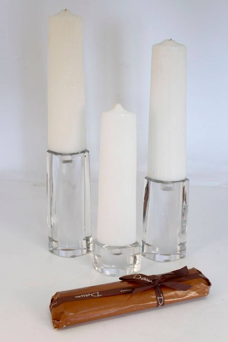 Set of three candleholders signed by Daum with original candles. 