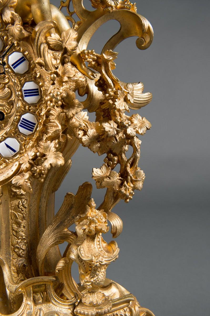 Rococo A French Gilt Bronze Figural Clock. For Sale