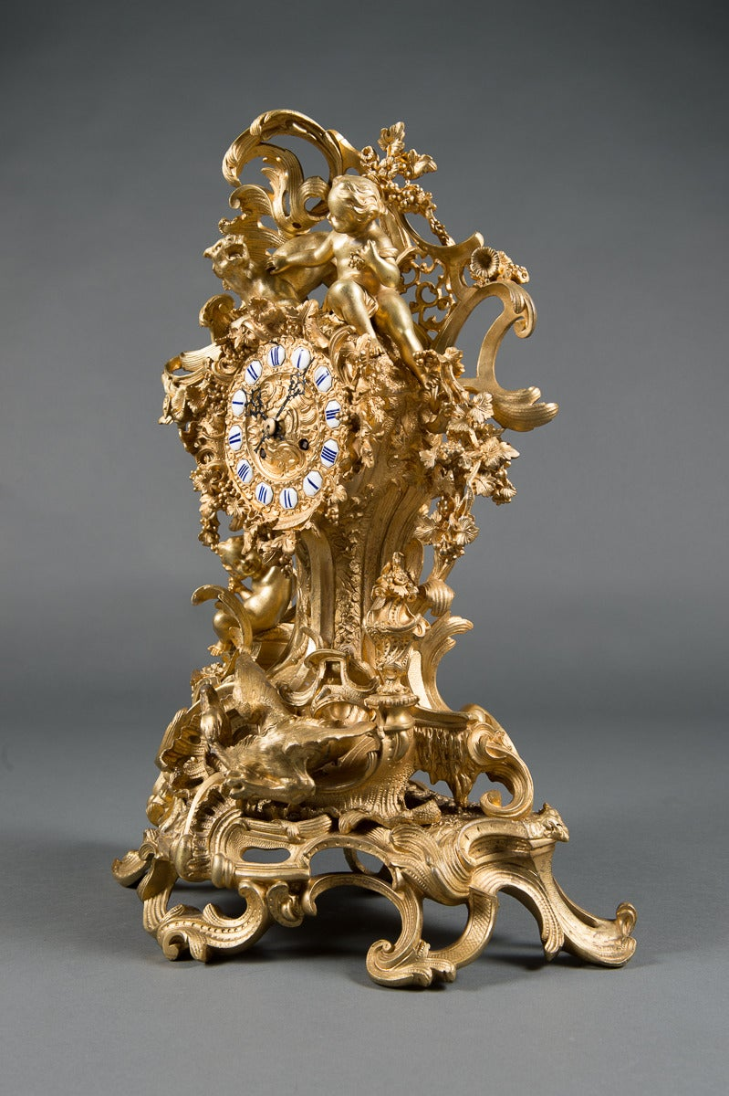 A French Gilt Bronze figural clock.  France, Circa 1890  Dimensions: Height: 25