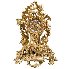 A French Gilt Bronze Figural Clock.