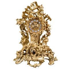 A French Gilt Bronze Figural Clock.