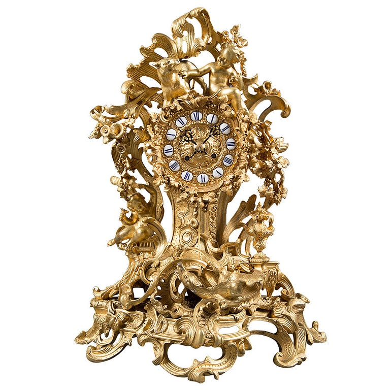 A French Gilt Bronze Figural Clock. For Sale