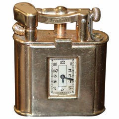 A Vintage Dunhill 9K Gold Petrol Pocket Lighter