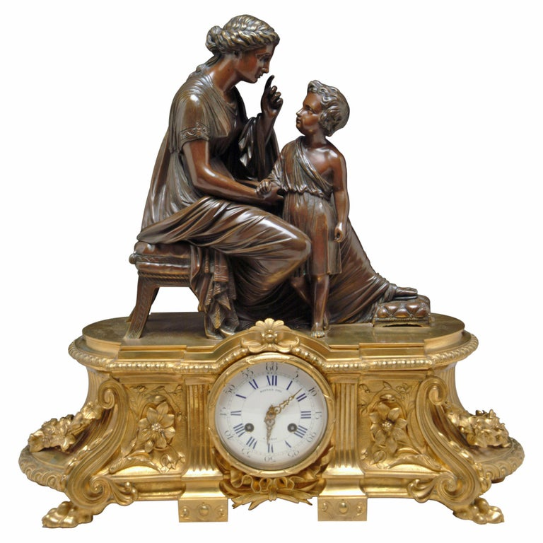 A 19th Century French Gilt & Patinated Bronze Figural Mantel Clock by Raingo For Sale