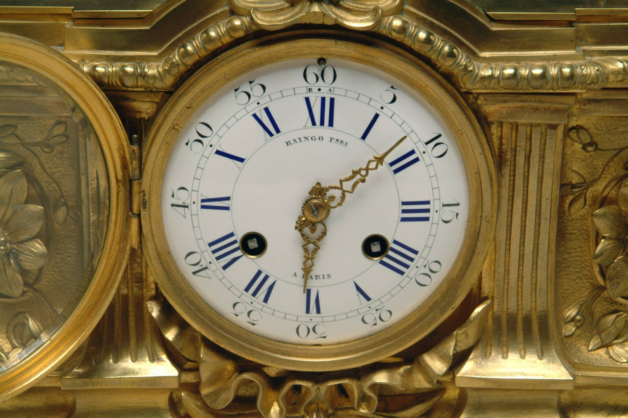 Louis XV A 19th Century French Gilt & Patinated Bronze Figural Mantel Clock by Raingo For Sale