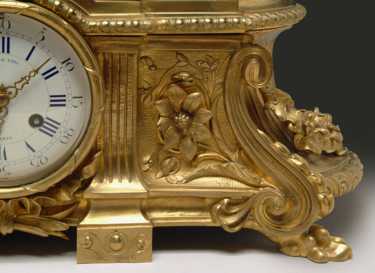 A 19th Century French Gilt & Patinated Bronze Figural Mantel Clock by Raingo In Excellent Condition For Sale In Los Angeles, CA