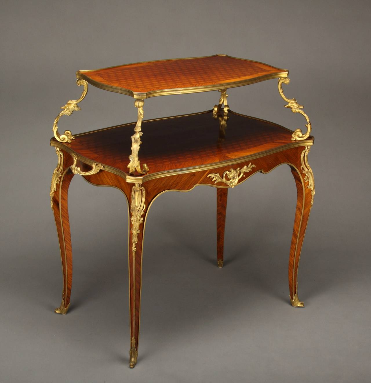 A French gilt bronze-mounted Louis XV style parquetry two-tier/pastry table - French Antique Gilt Bronze-Mounted Parquetry Two-Tier Table Or Tea