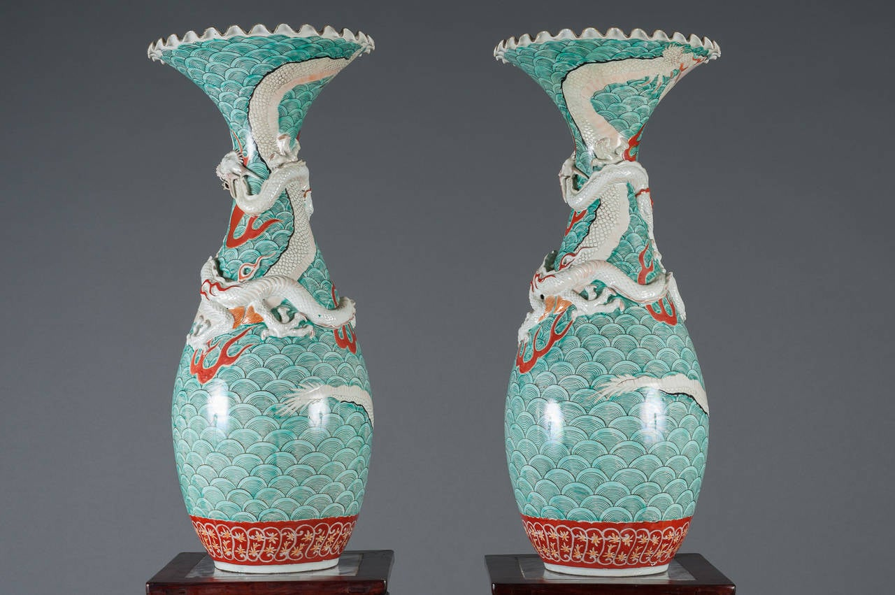 A pair of antique japanese porcelain vases with dragon motif for a pair of antique japanese porcelain vases with dragon motif circa 1900 origin japan height reviewsmspy