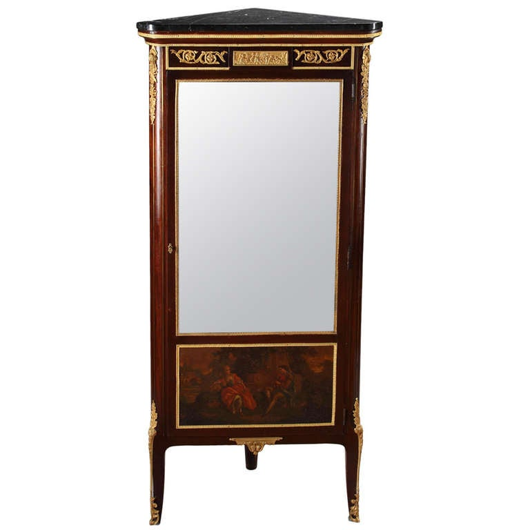 A French Ormolu Mounted Louis XVI Style Marble Top Mahogany Corner Cabinet