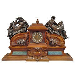A Large French Renaissance Revival Bronze Mounted Carved Walnut Mantel Clock