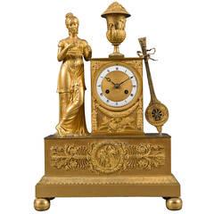 A French Antique Empire Gilt Bronze Silk Thread Mantel Clock, Circa 1820