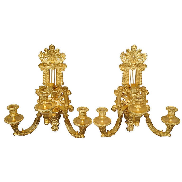 Antique French Wall Sconces : A Pair of French Antique Gilt Bronze Three-Light Wall Sconces With Figural Heads For Sale at 1stdibs