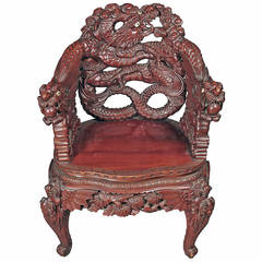 A Chinese Export Carved Rosewood Armchair with Dragon Handles