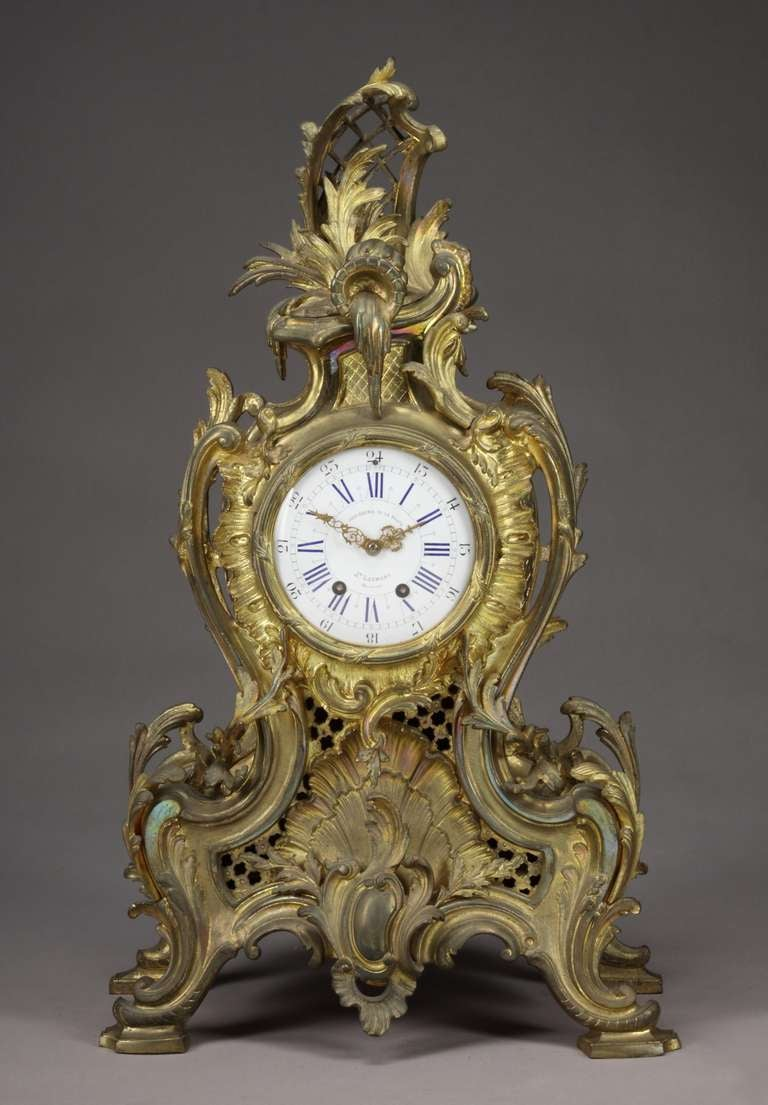 A 19th century Belgian gilt bronze Louis XV style mantel clock. 