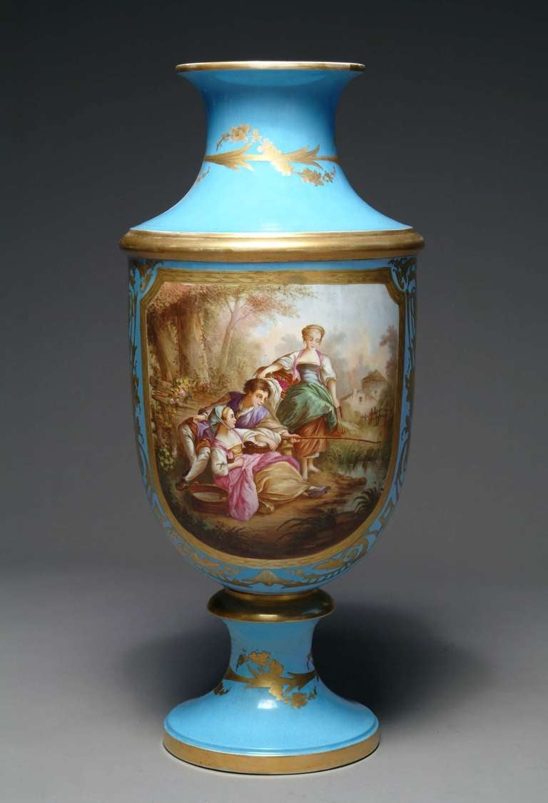 A 19th century French Sevres style turquoise porcelain vase.  Front hand-painted with a romantic scene and the back with a landscape.  Height: 31