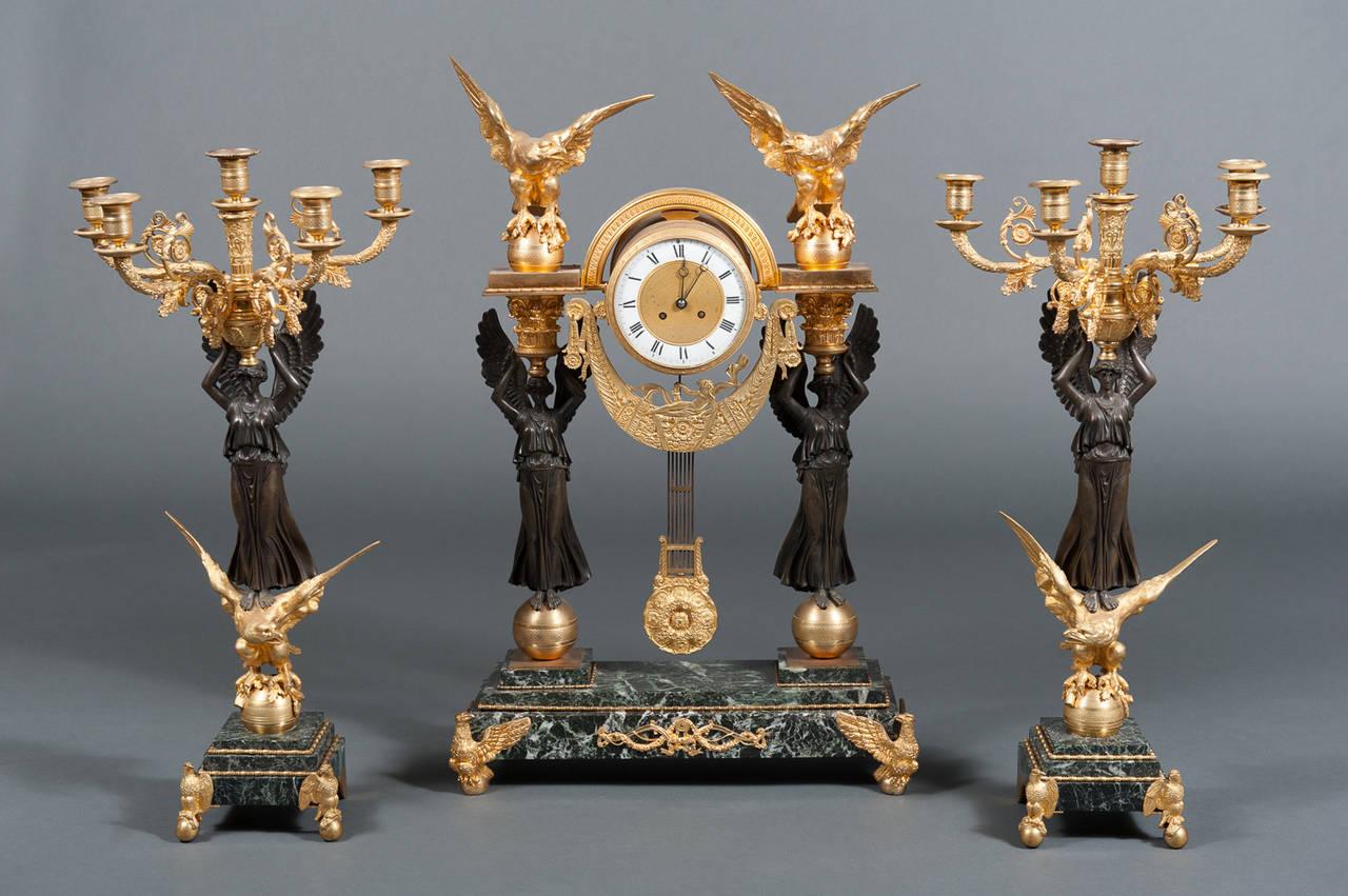 An exquisite French second Empire ormolu bronze and green marble three-piece clock garniture clock set,  circa 1820.  Origin: France  Measures: Clock Height 32