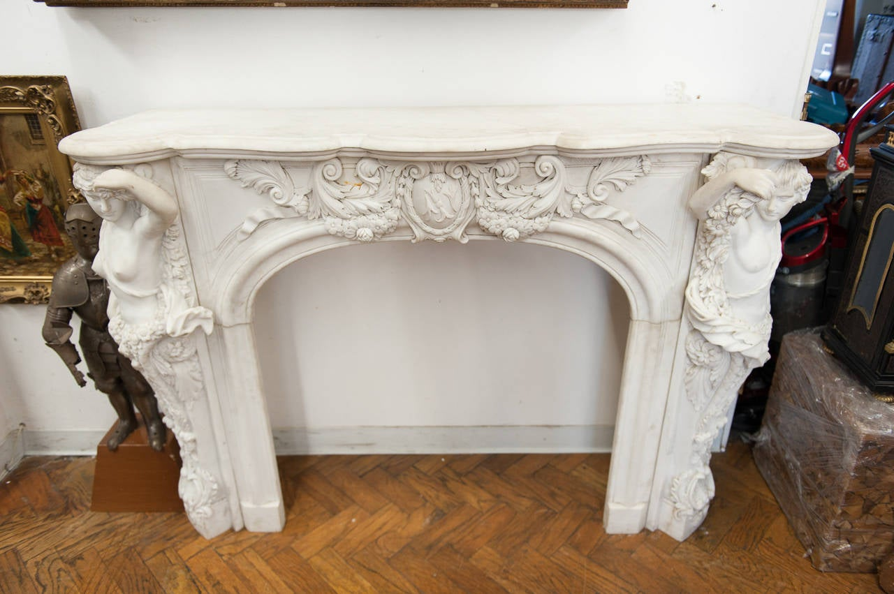 a large italian marble fire place mantel depicting a man and women