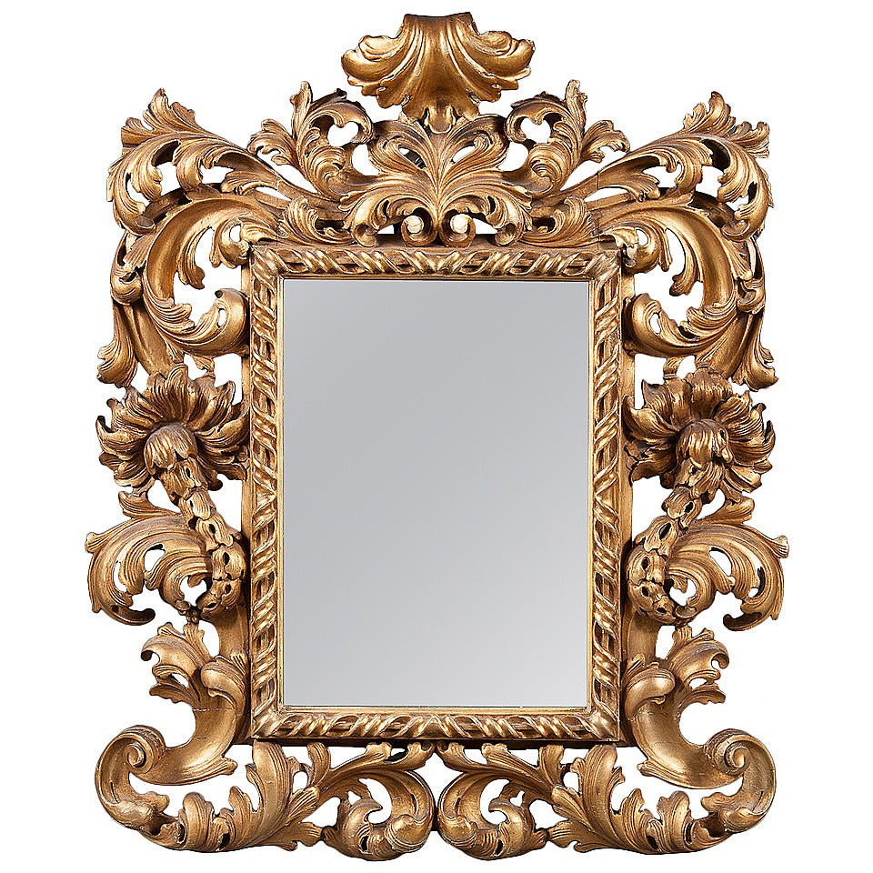 An intricate 19th century french giltwood rococo style for Baroque style wall mirror