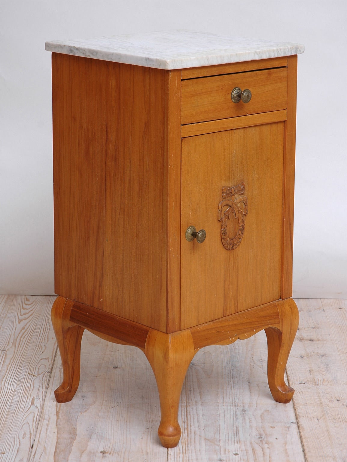 A Cherry Night Stand From The Early 1900 S With White Marble Top One Drawer