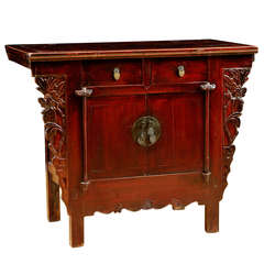 Chinese Qing Cinnabar Red Cabinet with Carved Peonies, circa 1800