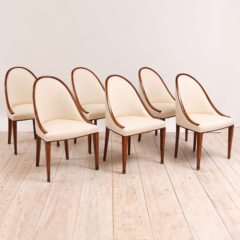Offers a fresh and classic look with crisp design combined with details such as the satinwood banding and the parquetry inlaid on each of the chairs' tapered legs. A very comfortable chair. Newly upholstered in a cream-colored cotton