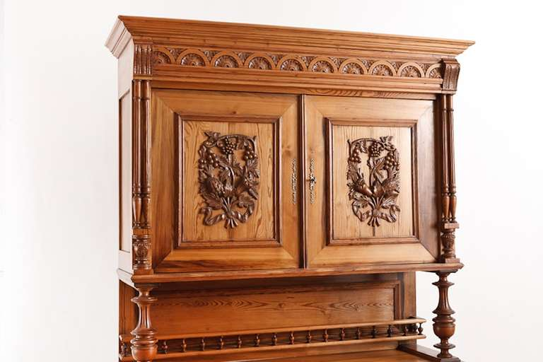 French harvest buffet in pitch pine from the region of Brittany, circa 1860 with intricately carved panels depicting duck, fruit and foliage. Perfect in your storage cupboard in your kitchen or dining area. Materials & Techniques: Pitch pine is