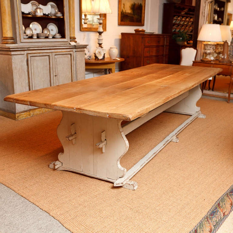 An exceptional Swedish Gustavian-style dining table with a thick, solid oak top and warm white/grey painted trestle base that comfortably seats 12. Sweden, circa 1850 or earlier. Foot rests between trestles are decorative and can easily be removed